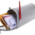 bigstock-Grey-Mailbox-full-of-mail-isol-61014551